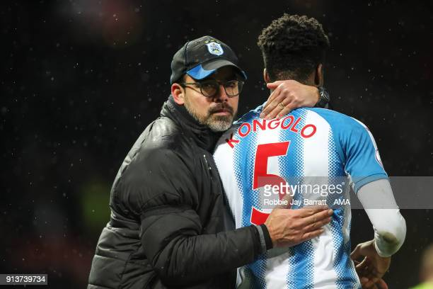 David Wagner head coach / manager of Huddersfield Town and Terence Kongolo of Huddersfield Town at full time during the Premier League match between...