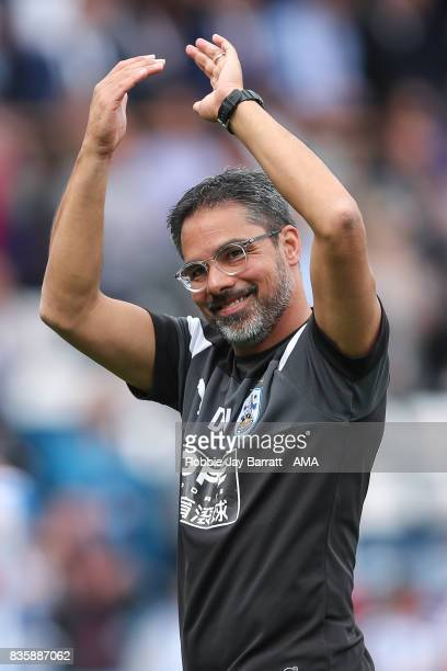 David Wagner head coach / manager of Huddersfield Town applauds the fans at full time during the Premier League match between Huddersfield Town and...