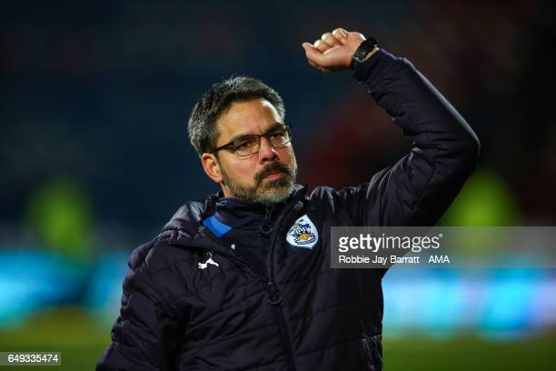 David Wagner head coach / manager of Huddersfield Town celebrates with the fans at full time during the Sky Bet Championship match between...