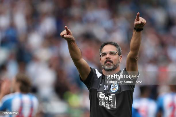 David Wagner head coach / manager of Huddersfield Town celebrates with the fans at full time during the Premier League match between Huddersfield...