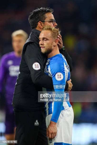David Wagner head coach / manager of Huddersfield Town consoles a dejected Alex Pritchard of Huddersfield Town at full time during the Premier League...