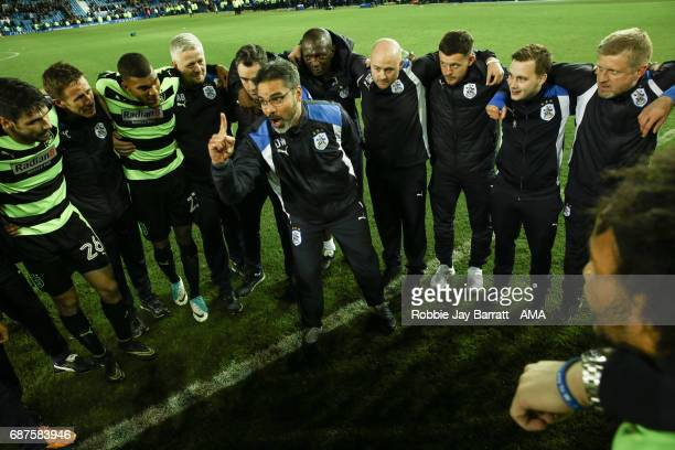 David Wagner head coach / manager of Huddersfield Town gives his team a team talk at full time during the Sky Bet Championship match between...