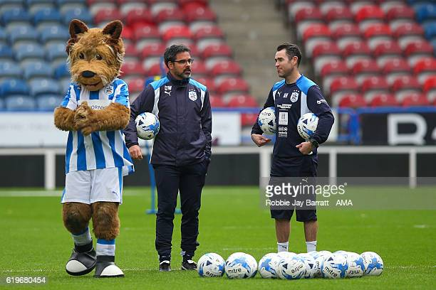 David Wagner head coach / manager of Huddersfield Town talks to Andrew Hughes first team coach of Huddersfield Town during the Huddersfield Town Open...
