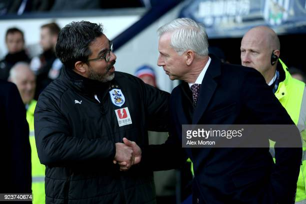 David Wagner Manager of Huddersfield Town and Alan Pardew Manager of West Bromwich Albion shake hands ahead of the Premier League match between West...