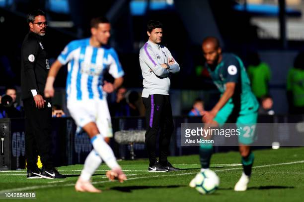 David Wagner manager of Huddersfield Town and Mauricio Pochettino Manager of Tottenham Hotspur look on during the Premier League match between...