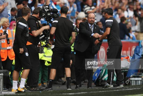 David Wagner Manager of Huddersfield Town and Rafael Benitez Manager of Newcastle United shake hands after the Premier League match between...