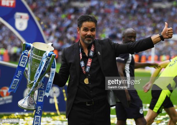 David Wagner Manager of Huddersfield Town celebrates with The Championship play off trophy after the Sky Bet Championship play off final between...