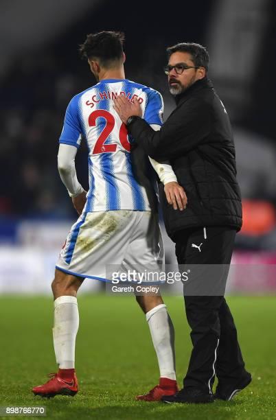 David Wagner Manager of Huddersfield Town congratulates Christopher Schindler of Huddersfield Town after the Premier League match between...