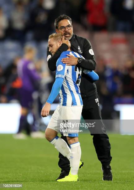 David Wagner Manager of Huddersfield Town embraces Alex Pritchard of Huddersfield Town at the final whistle during the Premier League match between...