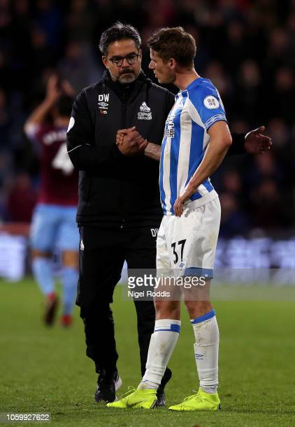 David Wagner Manager of Huddersfield Town embraces Eric Durm of Huddersfield Town after the Premier League match between Huddersfield Town and West...