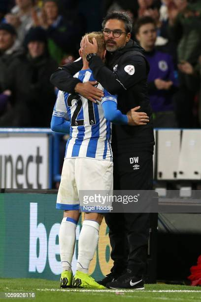 David Wagner Manager of Huddersfield Town greets Alex Pritchard of Huddersfield Town as Alex Pritchard is substituted off during the Premier League...