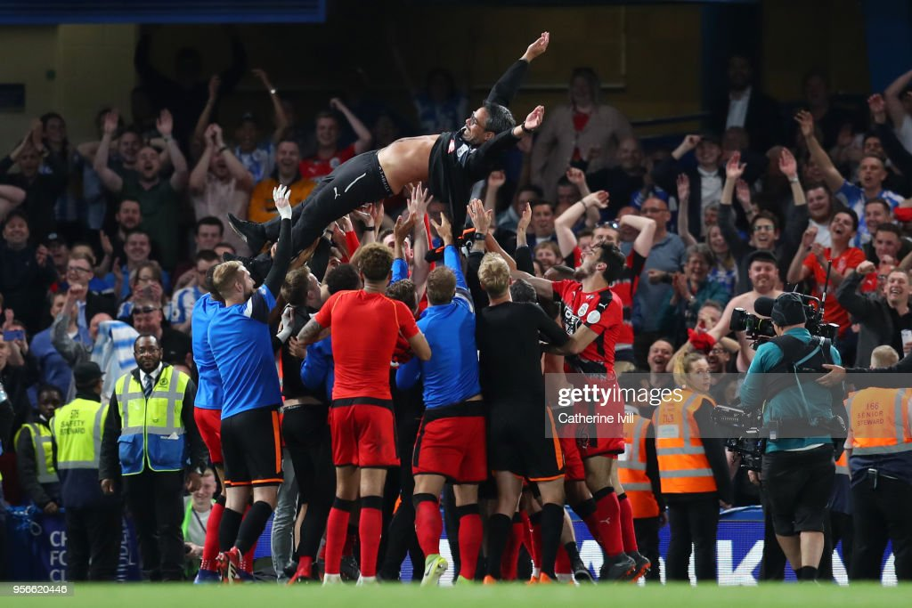 David Wagner, Manager of Huddersfield Town is throw into the air in celebration as his team avoid relegation after the Premier League match between Chelsea and Huddersfield Town at Stamford Bridge on May 9, 2018 in London, England.