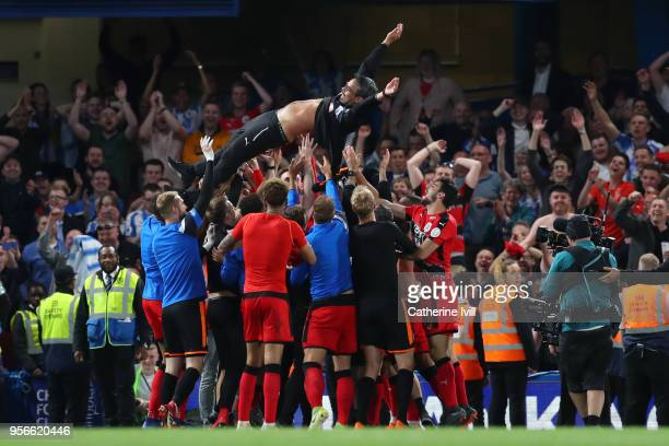 David Wagner Manager of Huddersfield Town is throw into the air in celebration as his team avoid relegation after the Premier League match between...