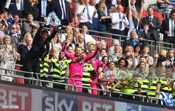 David Wagner Manager of Huddersfield Town lifts The Championship play off trophy after gaining promotion to the Premier Leauge after the Sky Bet...