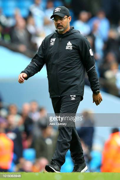 David Wagner manager of Huddersfield Town looks on after the Premier League match between Manchester City and Huddersfield Town at Etihad Stadium on...