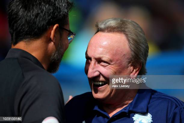 David Wagner manager of Huddersfield Town shakes hands with Neil Warnock Manager of Cardiff City during the Premier League match between Huddersfield...