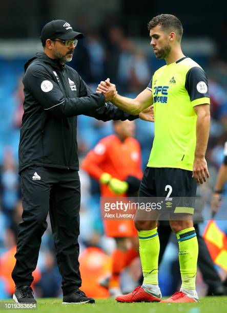 David Wagner manager of Huddersfield Town shakes hands with Tommy Smith of Huddersfield Town after the Premier League match between Manchester City...