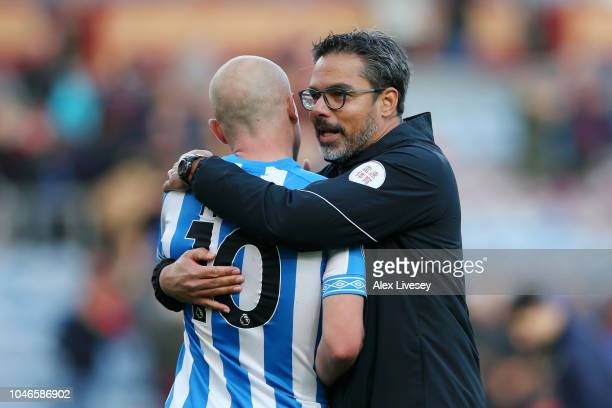David Wagner manager of Huddersfield Town speaks with Aaron Mooy of Huddersfield Town after the Premier League match between Burnley FC and...