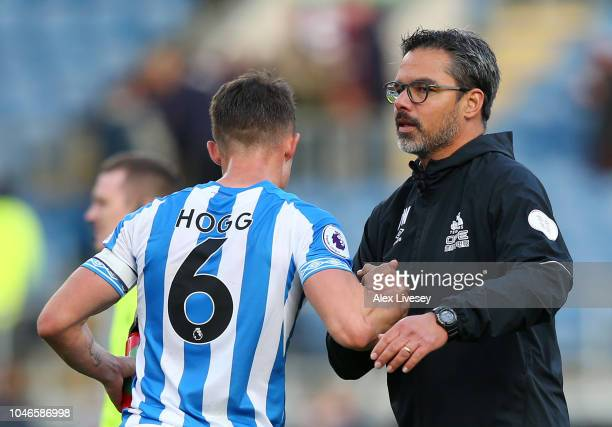 David Wagner manager of Huddersfield Town speaks with Jonathan Hogg of Huddersfield Town after the Premier League match between Burnley FC and...