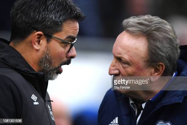David Wagner Manager of Huddersfield Town talks with Neil Warnock Manager of Cardiff City prior to the Premier League match between Cardiff City and...