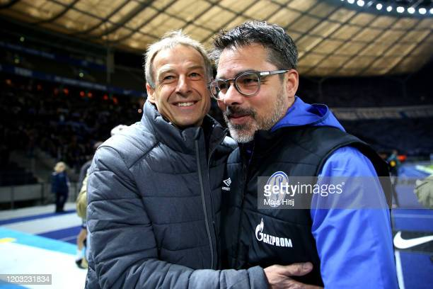 David Wagner Manager of Schalke 04 and Jurgen Klinsmann Manager of Hertha Berlin embrace during the Bundesliga match between Hertha BSC and FC...