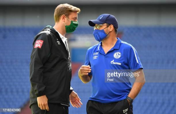 David Wagner, Manager of Schalke and Florian Kohfeldt, Manager of Bremen chat prior to the Bundesliga match between FC Schalke 04 and SV Werder...