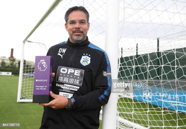 David Wagner of Huddersfield Town poses with the Barclays Manager of the Month Award for August 2017 September 7, 2017 in Huddersfield, England.