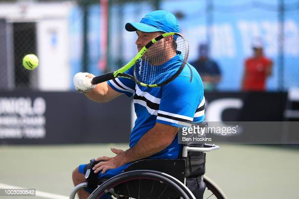 David Wagner of The USA plays a backhand during the final of the men's quad doubles against Ymanitu Silva of Brazil and Shota Kawano of Japan on day...