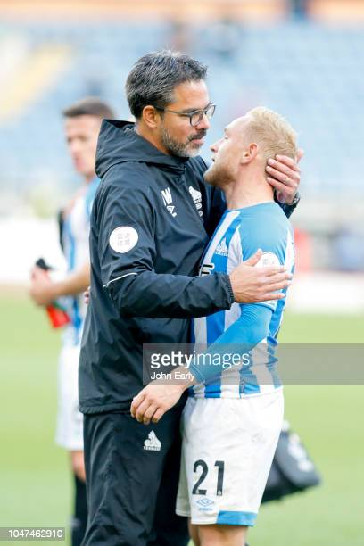 David Wagner the head coach of Huddersfield Town consoles Alex Pritchard of Huddersfield Town after the Premier League match between Burnley FC and...