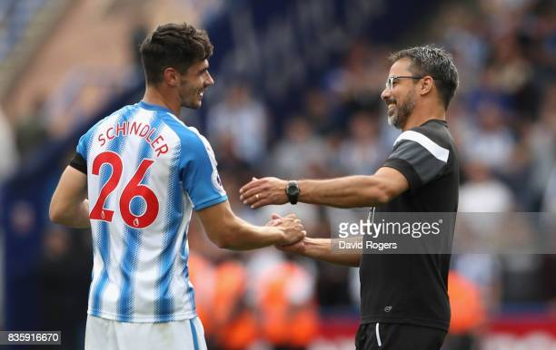 David Wagner the Huddersfield Town manager celebrates with Christopher Schindler after their victory during the Premier League match between...