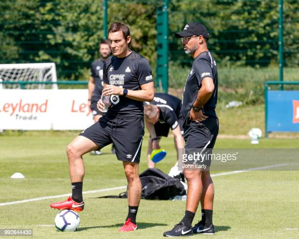 David Wagner the manager of Huddersfield Town and Dean Whitehead coach of Huddersfield Town watch pre season training on July 5 2018 in Huddersfield...