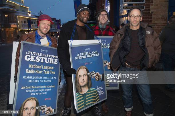 David Wain poses for a photo with sandwich board advertisers before the cast from Netflix's upcoming film 'A Futile And Stupid Gesture' performed...