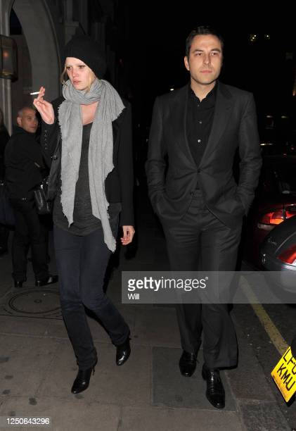 David Walliams and an unidentified woman leave Nobu Berkeley restaurant on October 14, 2009 in London, England.