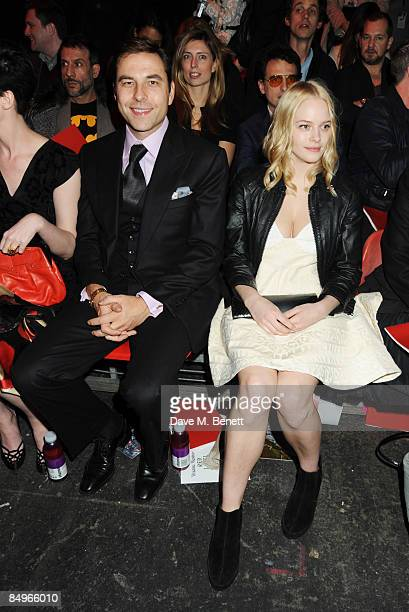 David Walliams and Annabelle Horsey pose in the front row for Vivienne Westwood Red Label show during the London Fashion Week a/w 2009 at Olympia on...
