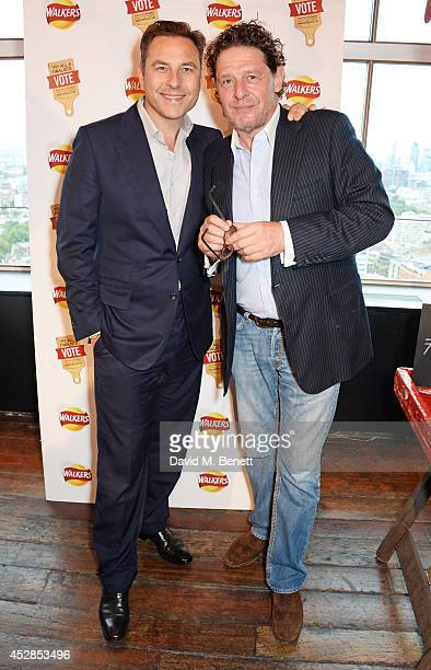 David Walliams and Marco Pierre White attend the 'Walkers 'Do Us A Flavour' finalists launch at Paramount Centre Point on July 28 2014 in London...