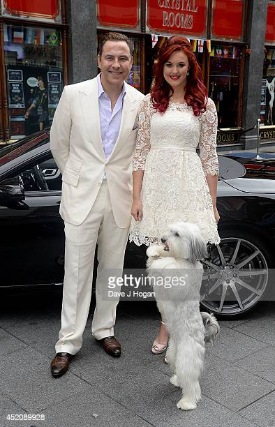 David Walliams Ashleigh Bulter and Pudsey attend the World Premiere of 'Pudsey The Dog The Movie' at Vue West End on July 13 2014 in London England