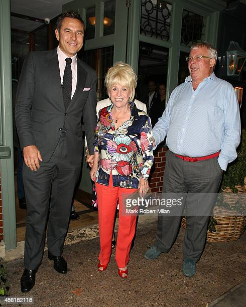 David Walliams Barbara Windsor and Christopher Biggins at the Ivy Garden Kings Road restaurant on September 1 2015 in London England