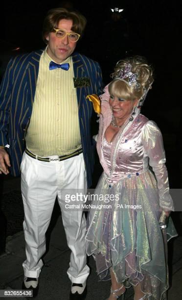 David Walliams dressed as Christopher Biggins and Barbara Windsor arrive at the pantomimethemed reception for the civil partnership between Matt...