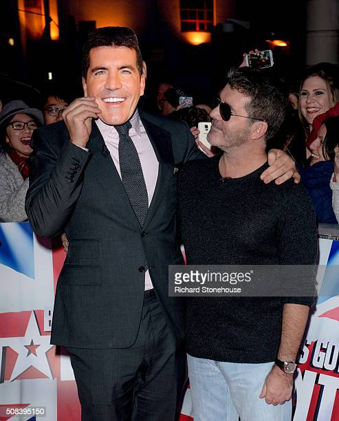 David Walliams puts a Simon Cowell Mask in front of his face next to Simon as they arrive at the Birmingham audtions for Britain's Got Talent at...
