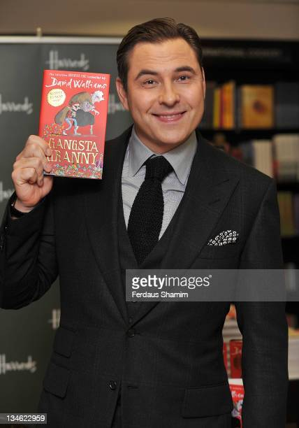 David Walliams signs his children's novel 'Gangsta Granny' at Harrods on December 3 2011 in London England