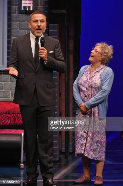 David Walliams speaks as cast member Gilly Tompkins looks on at the curtain call during the press night performance of David Walliams' Gangsta Granny...