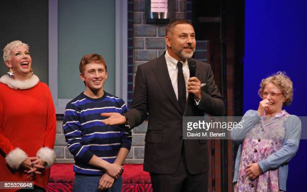 David Walliams speaks as cast members Rachel Stanley Ashley Cousins and Gilly Tompkins look on at the curtain call during the press night performance...