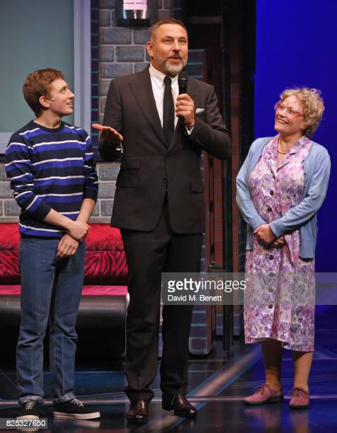 David Walliams speaks at cast members Ashley Cousins and Gilly Tompkins look on at the curtain call during the press night performance of David...