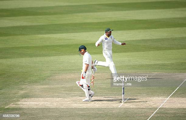 David Waner of Australia leaves the pitch after he is caught by Yasir Shah of Pakistan off the bowling of Rahat Ali during Day Three of the Second...