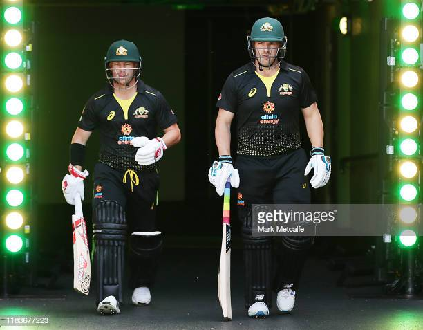 David Warner and Aaron Finch of Australia walk out to bat during the Twenty20 International match between Australia and Sri Lanka at Adelaide Oval on...