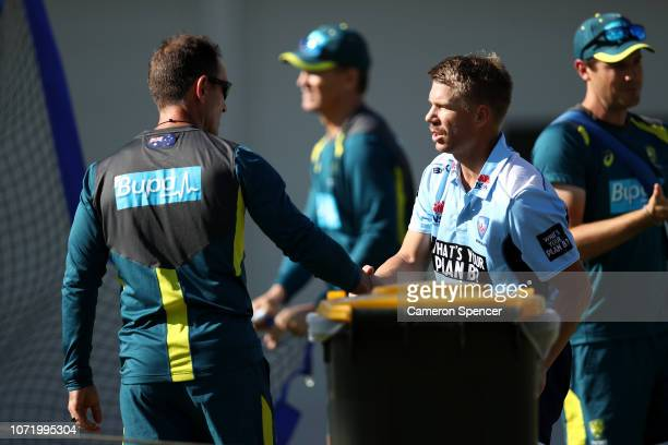 David Warner and Australian coach Justin Langer talk in the nets before the International Twenty20 match between Australia and India at Sydney...