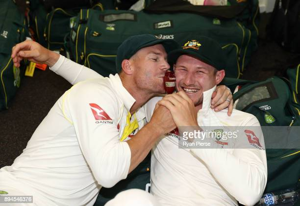 David Warner and Cameron Bancroft of Australia celebrate in the changerooms after Australia regained the Ashes during day five of the Third Test...