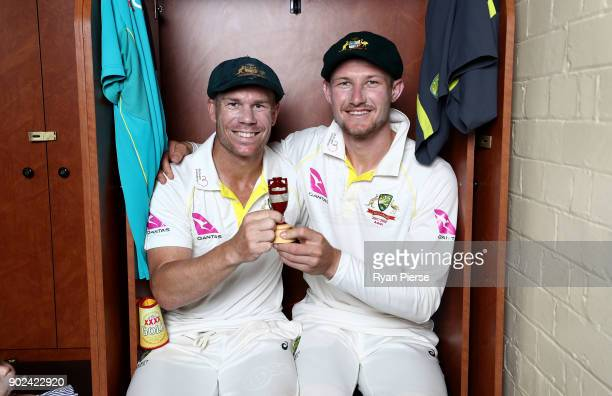 David Warner and Cameron Bancroft of Australia celebrate with the Ashes Urn in the change rooms during day five of the Fifth Test match in the...