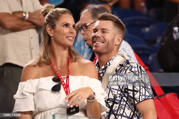David Warner and Candice Warner watch the men's semi final match between Novak Djokovic of Serbia and Lucas Pouille of France during day 12 of the...