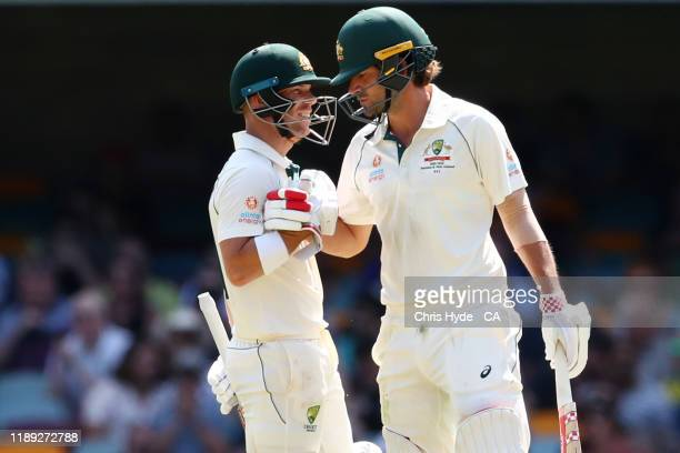 David Warner and Joe Burns of Australia celebrate their 150 runs partnership during day two of the 1st Domain Test between Australia and Pakistan at...